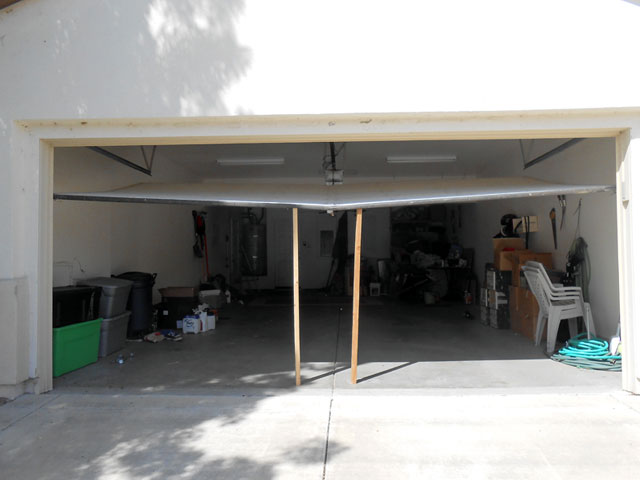 Repair bent sacramento garage door garage door repair for Sacramento garage doors