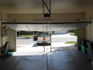 Repair bent garage door in Sacramento.