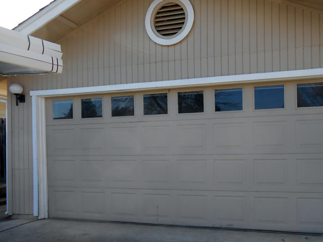 Repair dented ripped garage door in sacramento garage for Sacramento garage doors